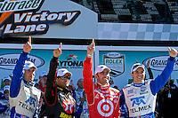 The winners in Victory Lane (L to R): Scott Pruett, Juan Pablo Montoya, Dario Franchitti and Memo Rojas.