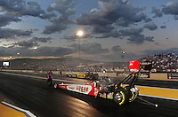 Jul, 22, 2011; Morrison, CO, USA: NHRA top fuel dragster driver Shawn Langdon being guided back after the burnout during qualifying for the Mile High Nationals at Bandimere Speedway. Mandatory Credit: Mark J. Rebilas-