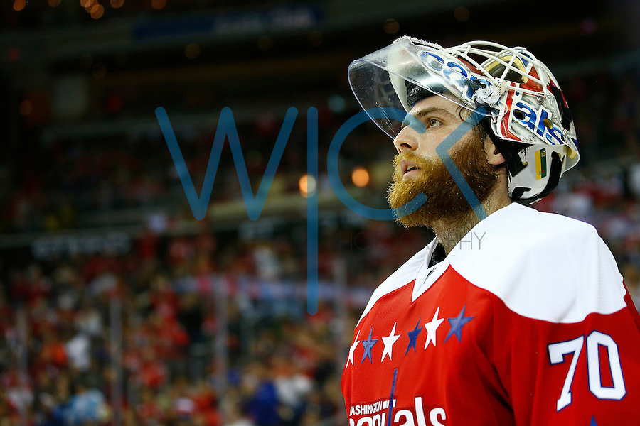 Braden Holtby #70 of the Washington Capitals looks on during a break in the third period against the Pittsburgh Penguins during the game at the Verizon Center in Washington, D.C. on April 7, 2016. (Photo by Jared Wickerham / DKPS)