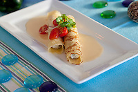 Crab, Roasted Poblano and Ricotta Crêpes:  lobster butter, grape tomatoes, micro greens.  Waterfront Bistro .Cruz Bay, St. John.U.S. Virgin Islands