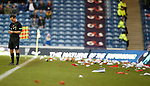 Linesman Colin McAlipne pelted with the debris from the card display