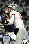 """Marshall Lobbestael (#8), Washington State quarterback, looks down field for an open receiver during the Cougars Pac-10 conference """"Apple Cup"""" showdown with arch-rival Washington at Husky Stadium in Seattle, Washington, on November 28, 2009.  The Cougars lost to the Huskies in the game, 30-0."""