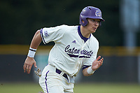 Nate Stocum (16) of the Western Carolina Catamounts hustles towards home plate against the St. John's Red Storm at Childress Field on March 13, 2021 in Cullowhee, North Carolina. (Brian Westerholt/Four Seam Images)