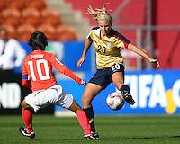 Olivia Klei (USA) keeps the ball from So Yun Ji (KOR)..FIFA U17 Women's World Cup, USA v Korea Republic, Waikato Stadium, Hamilton, New Zealand, Sunday 9 November 2008. Photo: Renee McKay/PHOTOSPORT