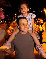 Andrew Greenhill holds his daughter, Sophia, 5, as he walks in the Parade of Little Angels Saturday night. The event was part of All Souls Procession festivities and took place at the downtown main library, 100 North Stone Ave.