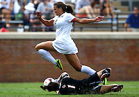 WINSTON-SALEM, NORTH CAROLINA - September 01, 2013:<br /> Paige Brown (1) of Louisville University dives at the feet of Katie Stengel (12)of Wake Forest University during a match at the Wake Forest Invitational tournament at Wake Forest University on September 01. The match was abandoned early in the second half due to severe weather with Wake leading 1-0.