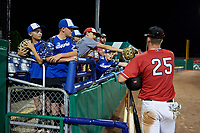 Batavia Muckdogs Sean Reynolds (25) fist bumps young fans after a NY-Penn League game against the Lowell Spinners on July 11, 2019 at Dwyer Stadium in Batavia, New York.  Batavia defeated Lowell 5-2.  (Mike Janes/Four Seam Images)