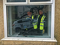 """Pictured: A front room bay window is being repaired after being vandalised in Waun-Wen Road in the Mayhill area of Swansea, Wales, UK. Friday 21 May 2021<br /> Re: Gangs of """"yobs"""" have been setting fire to cars and rolling them down a hill in Swansea, Wales, UK.<br /> South Wales Police said they attended """"large scale disorder"""" in the Mayhill area of the city on Thursday evening."""