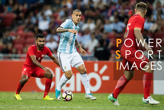 Leandro Paredes of Argentina (C) in action during the International Test match between Argentina and Singapore at National Stadium on June 13, 2017 in Singapore. Photo by Marcio Rodrigo Machado / Power Sport Images
