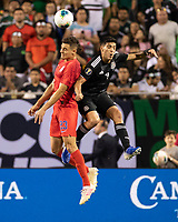 CHICAGO, IL - JULY 7: Aaron Long #23 and Raul Jimenez #9 go for a header during a game between Mexico and USMNT at Soldiers Field on July 7, 2019 in Chicago, Illinois.