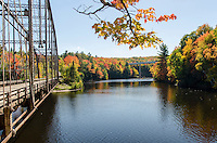 A view of the old historic County Road 510 and the new modern bridge surrounded by autumn splendor. Marquette, MI