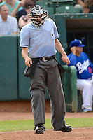 Home plate umpire Alex Mackay as the Ogden Raptors faced the Orem Owlz in Pioneer League play at Lindquist Field on July 07, 2013 in Ogden Utah. (Stephen Smith/Four Seam Images)