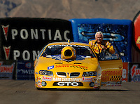 Apr 8, 2006; Las Vegas, NV, USA; NHRA Pro Stock driver Warren Johnson, driver of the GM Performance Parts Pontiac GTO returns to his pit area after qualifying for the Summitracing.com Nationals at Las Vegas Motor Speedway in Las Vegas, NV. Mandatory Credit: Mark J. Rebilas