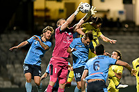 8th February 2021; Jubilee Stadium, Sydney, New South Wales, Australia; A League Football, Sydney Football Club versus Wellington Phoenix; Andrew Redmayne of Sydney catches the ball as Alex Rufer of Wellington Phoenix challenges