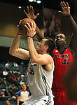 Reno Bighorns Christopher Ayer drives past Idaho Stampede's Derrick Caracter during a basketball game Sunday, April 1, 2012 in Reno, Nev. Idaho won 108-99..Photo by Cathleen Allison