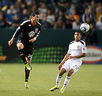 CARSON, CA – SEPTEMBER 18:  DC United midfielder Santino Quaranta (25) and LA Galaxy defender Sean Franklin (28) during a soccer match at Home Depot Center, September 18, 2010 in Carson California. Final score LA Galaxy 2, DC United 1.