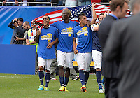 Chicago, IL - Sunday July 28, 2013:   USMNT players Edgar Castillo, Eddie Johnson, Joe Corona and Mix Diskerud celebrate by waving the American flag to fans after the USMNT defeated Panama by the score of 1-0 in the CONCACAF Gold Cup Finals soccer match between the USMNT and Panama, at Soldier Field in Chicago, IL.