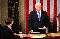 Vice President Mike Pence convenes a joint session of Congress to certify Joe Biden as the next US president in the US capitol in Washington, DC, USA, 06 January, 2021. President Donald J. Trump has refused to concede the election and is encouraging a group of lawmakers, along with Vice President Mike Pence, to back his baseless claims of voter fraud by overturning election results.<br /> Credit: Jim LoScalzo / Pool via CNP/AdMedia