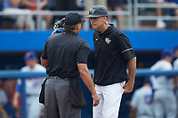 Wake Forest Demon Deacons head coach Tom Walter (16) stares down home plate umpire Perry Costello during the game against the Florida Gators in the completion of Game Two of the Gainesville Super Regional of the 2017 College World Series at Alfred McKethan Stadium at Perry Field on June 12, 2017 in Gainesville, Florida. The Demon Deacons walked off the Gators 8-6 in 11 innings. (Brian Westerholt/Four Seam Images)