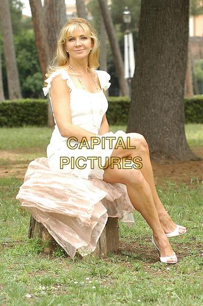 "NATASHA RICHARDSON.Photocall for ""Asylum"", Rome, Italy..June 6th, 2007.full length white dress sitting.CAP/CAV.©Luca Cavallari/Capital Pictures"
