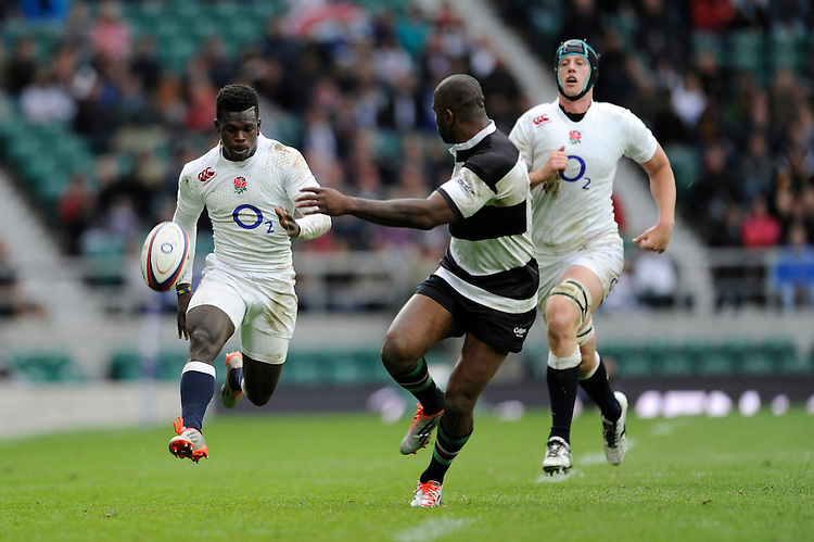 Christian Wade of England chases his own chip to score his hat trick of tries during the match between England and Barbarians at Twickenham Stadium on Sunday 31st May 2015 (Photo by Rob Munro)