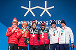 Brian McKeever and Graham Nishikawa, PyeongChang 2018 - Para Nordic Skiing // Ski paranordique.<br /> Brian McKeever and his guide Graham Nishikawa collect their gold medals in the men's 20km free visually impaired cross country event // Brian McKeever et son guide Graham Nishikawa remportent leur médaille d'or dans l'épreuve de cross-country libre avec un défiance visuelle du 20 km masculin. 12/03/2018.