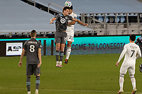 ST PAUL, MN - NOVEMBER 4: Aaron Schoenfeld #12 of Minnesota United FC and Mauricio Pineda #22 of Chicago Fire FC battle for the ball during a game between Chicago Fire and Minnesota United FC at Allianz Field on November 4, 2020 in St Paul, Minnesota.