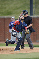 NJIT Highlanders catcher Edgar Badaraco (28) tracks a pop fly as home plate umpire Chris Barneycastle looks on during the game against the High Point Panthers at Williard Stadium on February 18, 2017 in High Point, North Carolina. The Highlanders defeated the Panthers 4-2 in game two of a double-header. (Brian Westerholt/Four Seam Images)