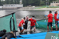 28th August 2021; Tokyo, Japan; Michael Taylor (GBR),   Triathlon is helped put of the swim routine at the Odaiba Marine Park in Tokyo, Japan.