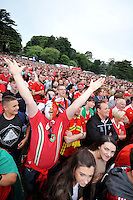 Wednesday 6th July 2016<br /> Welsh supporters watch the UEFA Euro 2016 Portugal v Wales semi-final on a giant screen in a fan zone in Swansea, Wales, UK