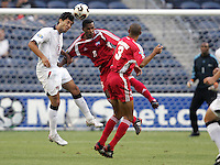 7 July 2005: Clint Dempsey of USA battles for the ball in the air with Alexander Cruzata of Cuba during the first half of the game during CONCACAF Gold Cup at Qwest Stadium in Seattle, Washington. Credit: Michael Pimentel / ISI