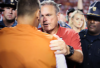 Arkansas head coach Sam Pittman shakes hands with Texas head coach Steve Sarkisian, Saturday, September 11, 2021 during a football game at Reynolds Razorback Stadium in Fayetteville. Check out nwaonline.com/210912Daily/ for today's photo gallery. <br /> (NWA Democrat-Gazette/Charlie Kaijo)