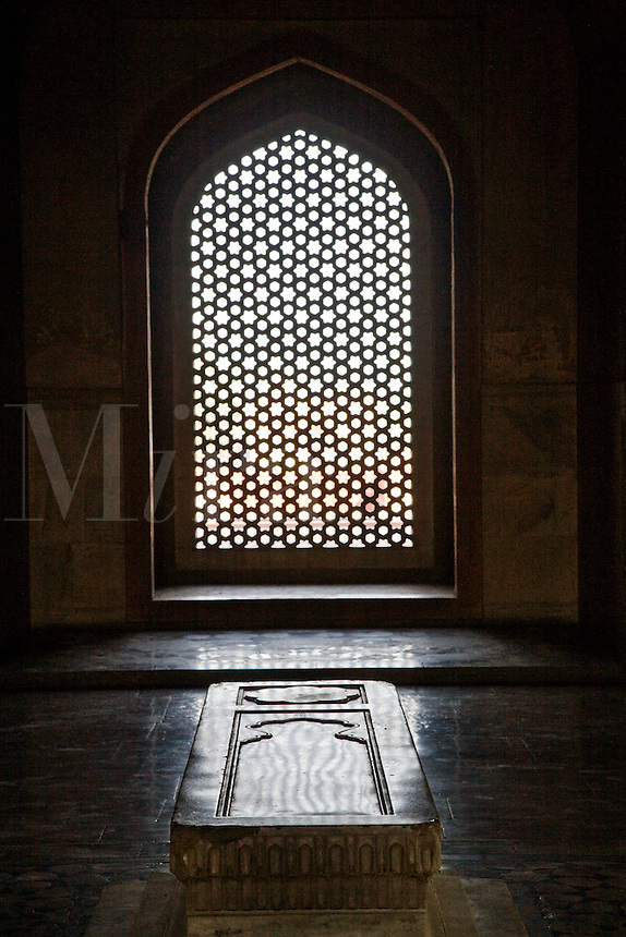 There are over 100 graves like this white marble tomb in HUMAYUN'S TOMB which is a fine example of MUGHAL architechture - NEW DELHI, INDIA