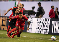 CHICAGO, IL - JULY 7: Rodolfo Pizarro #20, Weston Mckennie #8 and Michael Bradley #4 go after the ball during a game between Mexico and USMNT at Soldiers Field on July 7, 2019 in Chicago, Illinois.