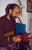 Tunisian Hat, Chechia.  Yusuf bin Ali, Brushing a Chechia with Metal Thistle-combs.