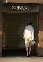 A man enter the College subway station on..Carlton street , east of Yonge in Toronto