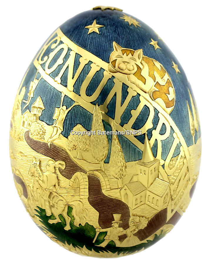 BNPS.co.uk (01202 558833)<br /> Pic: Batemans/BNPS<br /> <br /> A special Cadbury's Golden Egg which was commissioned for a calamitous national treasure hunt 38 years ago has sold for a record £37,000.<br /> <br /> A dozen certificates entitling the finder to one of the 250-gram decorative eggs were buried in caskets across Britain and finders had to unravel cryptic clues to find the secret locations.<br /> <br /> But the chocolate company was forced to call it off due to the number of complaints from landowners sparked by hordes of people digging up private property and protected sites.