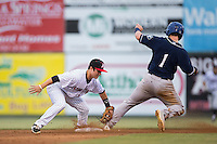 Brendan Rodgers (1) of the Asheville Tourists is tagged out by Bradley Strong (18) of the Kannapolis Intimidators as he tries to steal second base at Intimidators Stadium on May 28, 2016 in Kannapolis, North Carolina.  The Intimidators defeated the Tourists 5-4 in 10 innings.  (Brian Westerholt/Four Seam Images)
