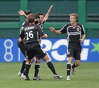 DC United midfielder Ben Olsen (14) celebrates the sencond goal of the game with teammates Bryan Namoff (26), Joshua Gros (17), and Brian Carroll (16). DC United defeated the New York Red Bulls, 4-2, at RFK Stadium in Washington DC, Sunday, June 10 , 2007.