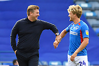 Oxford United Manager Karl Robinson left jokes with Cameron McGeehan of Portsmouth before kick off  during Portsmouth vs Oxford United, Sky Bet EFL League 1 Play-Off Semi-Final Football at Fratton Park on 3rd July 2020