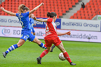 Emma Van Britsom (6) of AA Gent and Noemie Gelders (10) of Standard pictured during a female soccer game between Standard Femina de Liege and AA Gent Ladies on the 6th matchday in play off 1 of the 2020 - 2021 season of Belgian Scooore Womens Super League , tuesday 11 th of May 2021  in Liege , Belgium . PHOTO SPORTPIX.BE   SPP   STIJN AUDOOREN