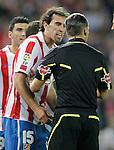 Atletico de Madrid's Diego Godin argues with the referee during La liga match. September 23, 2010. (ALTERPHOTOS/Alvaro Hernandez).