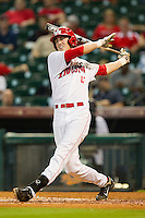 Chase Jensen #17 of the Houston Cougars follows through on his swing against the Tennessee Volunteers at Minute Maid Park on March 2, 2012 in Houston, Texas.  The Cougars defeated the Volunteers 7-4.  (Brian Westerholt/Four Seam Images)