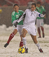 USA's Shannon Boxx (R) fights for the ball with Mexico'sDinora Garza (L) at Rio Tinto Stadium March 31, 2010 in Salt Lake City, Utah. The USA women won the match over Mexico 1-0.