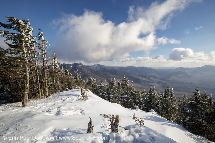 February 2014 - Winter view from Mount Tecumseh in Waterville Valley, New Hampshire. In 2011, this was only a small viewpoint, but illegal tree cutting has improved it. Forest Service is looking for any information that will identify the ones doing the cutting.