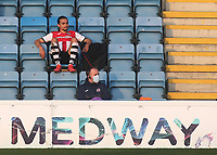Randell Williams of Exeter City looks quite relaxed as he sits in the main stand after being substituted in the second half during Gillingham vs Exeter City, Emirates FA Cup Football at the MEMS Priestfield Stadium on 28th November 2020