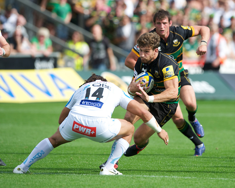 Dom Waldouck of Northampton Saints runs into Josh Tatupu of Exeter Chiefs during the Aviva Premiership match between Northampton Saints and Exeter Chiefs at Franklin's Gardens on Sunday 9th September 2012 (Photo by Rob Munro)