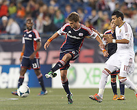 New England Revolution midfielder Scott Caldwell (6) passes the ball.  In a Major League Soccer (MLS) match, Real Salt Lake (white)defeated the New England Revolution (blue), 2-1, at Gillette Stadium on May 8, 2013.