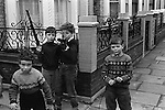 Young boys playing in the street with top runs. Chelsea, London 1970