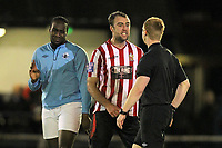 Elliot Styles of Hornchurch confronts referee Carl Fitch after a foul by Joe Benjamin (L) - AFC Hornchurch vs Billericay Town - Blue Square Conference South Football at The Stadium, Upminster Bridge, Essex - 29/12/12 - MANDATORY CREDIT: Gavin Ellis/TGSPHOTO - Self billing applies where appropriate - 0845 094 6026 - contact@tgsphoto.co.uk - NO UNPAID USE